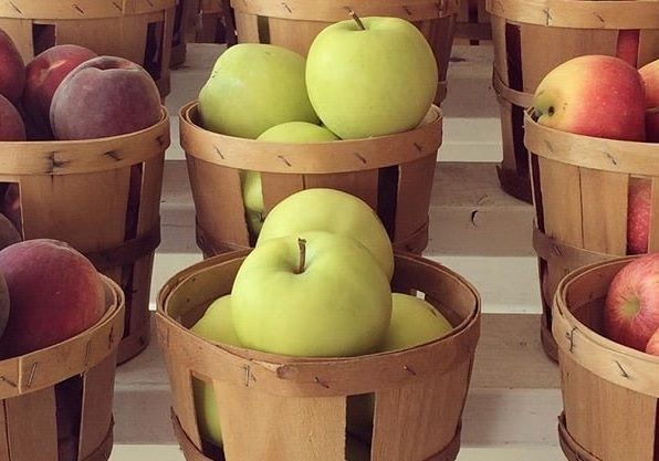 apples in baskets by Michele K