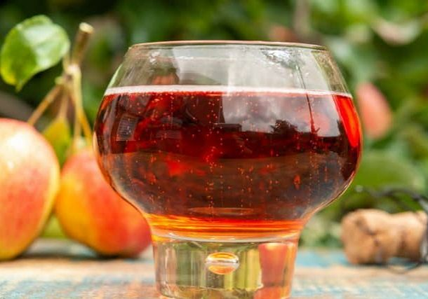 bigstock-Glass-Of-Rose-Apple-Cider-From-388654810