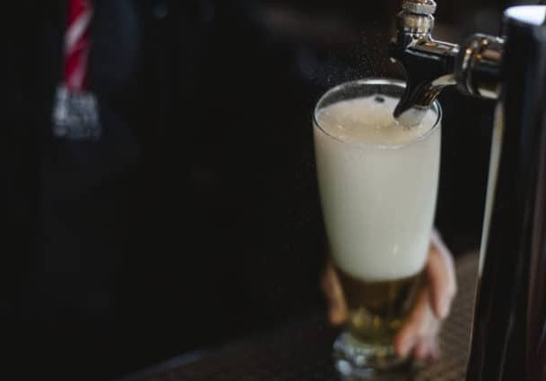 Credit: Alexandra Whitney Photography tags: cider, draft, glass, tap